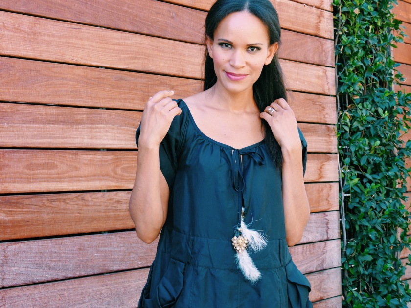 Amanda Luttrell Garrigus in a black swing dress with feather detail