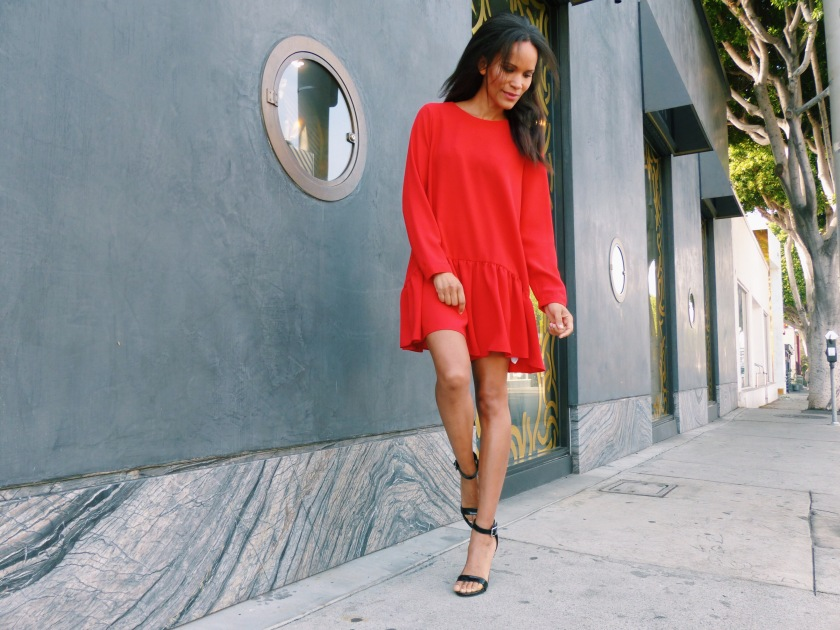 Amanda Luttrell Garrigus wearing a long sleever red romper