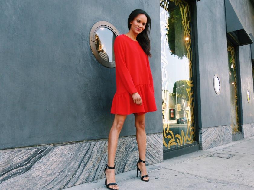Amanda Luttrell Garrigus wearing a red romper