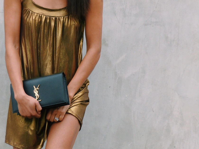 Amanda Luttrell Garrigus wearing a metallic dress with YSL clutch