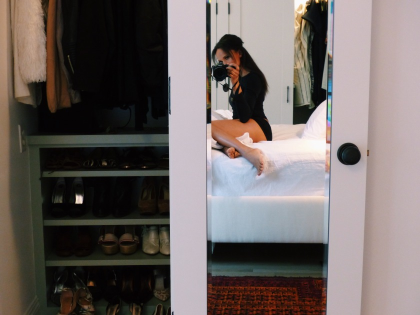 Amanda Garrigus shoe closet selfie from her bed