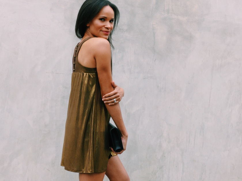 Amanda Luttrell Garrigus wearing a metallic swing dress
