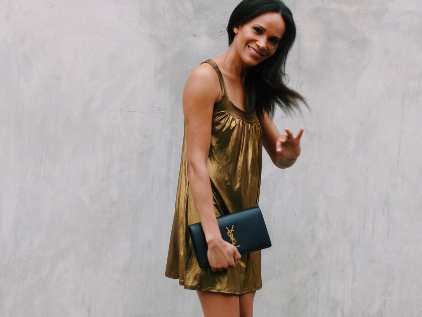 Amanda Luttrell Garrigus in a metallic dress with YSL clutch