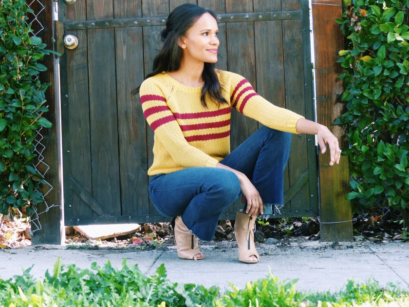 Amanda Luttrell Garrigus wearing cropped jeans and a mustard yellow sweater