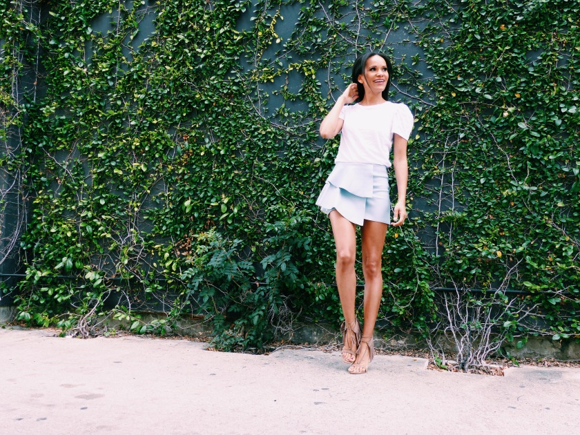 Amanda Luttrell Garrigus in a blue tiered mini skirt from Zara and fringe sandals