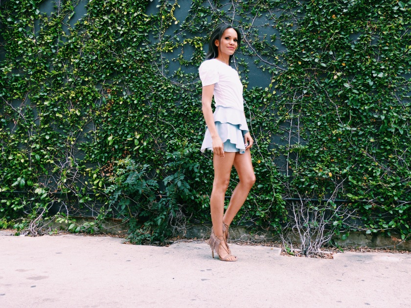 Amanda Luttrell Garrigus wearing a vegan leather pale blue mini skirt from Zara