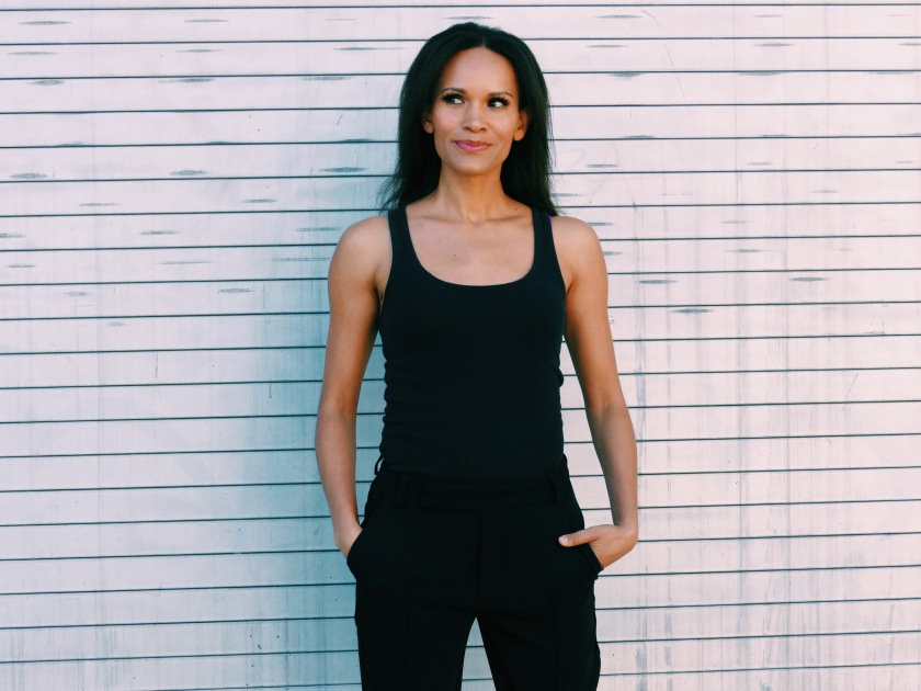 Amanda Luttrell Garrigus wearing slouchy suit pants and a black tank top