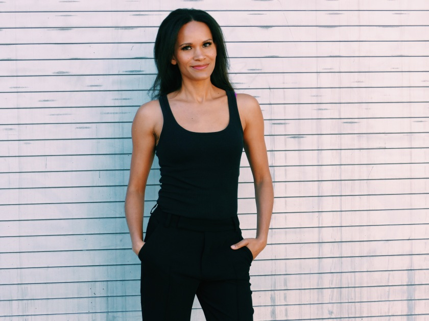 Amanda Luttrell Garrigus wearing slouchy trousers and a black tank top