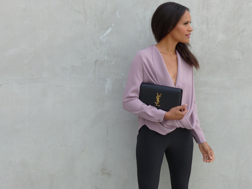Amanda Garrigus wearing a TOBI top with Theory Pants and a YSL clutch