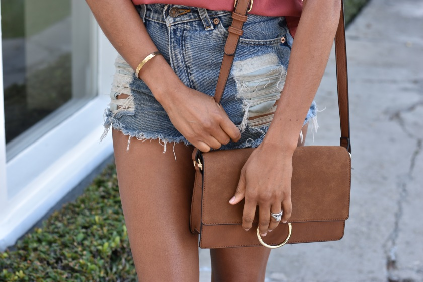 Amanda Luttrell Garrigus in denim cut offs and a faux chloe bag