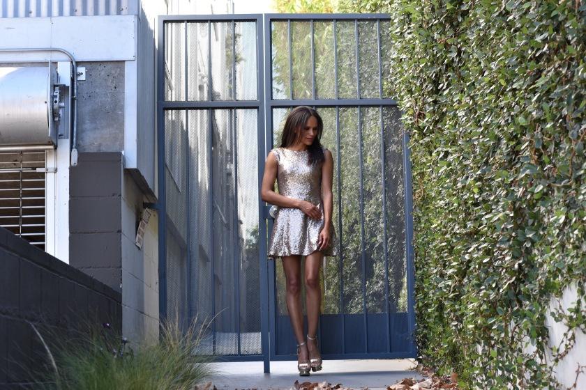 Amanda Luttrell Garrigus wearing a Gold mini dress by Tobi